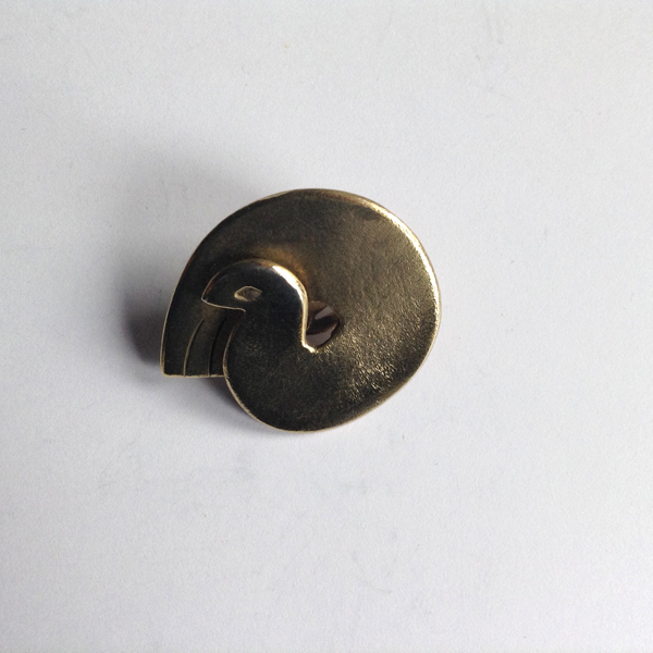 Sleeping dove brooch